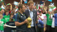 Prince Harry and former rugby union player Jonny Wilkinson arrive to cheers from children and pose with Webb Ellis Cup Prince Harry helped launch the...