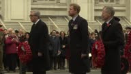 Prince Harry at Anzac Day Parade ENGLAND London Whitehall EXT Chelsea pensioners / Military band along / Veterans along with wreaths / Prince Harry...