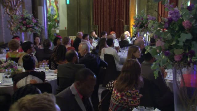Prince Harry attends dinner at Australia House Prince Harry watching video / seated with guests GVs as people leave the building at the end of the...