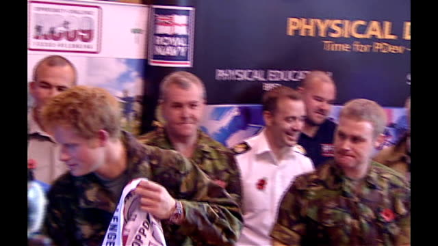 Prince Harry launches Khumbu Challenge 2009 Harry signs Khumbu Challenge 2009 flags that will be placed at the base of Mt Everest / Unidentified...