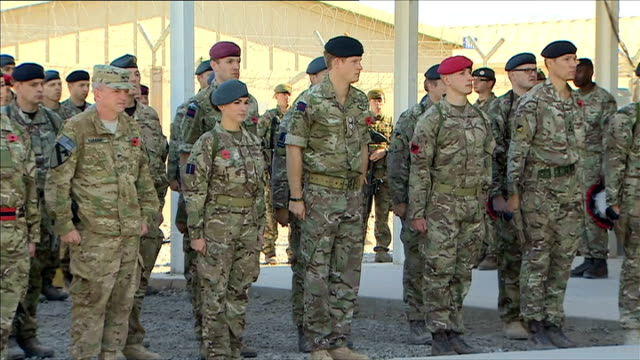 Prince Harry lays wreath during Remembrance Day service in Kandahar AFGHANISTAN Kandahar EXT GVs Soldiers in line during memorial service / Prince...