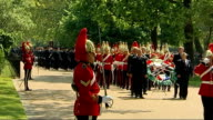 Prince Harry marches in the annual Combined Cavalry Old Comrades Association parade Prince Charles standing at podium with other officers as all...
