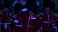 Prince Harry marks ANZAC Day at dawn service in London Prince Harry and others on podium as 'The Last Post' is played SOT