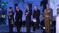 Prince Harry marks ANZAC Day at dawn service in London Prince Harry and others on platform as Lord's Prayer read by Reverend Steve Bennett SOT