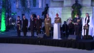 Prince Harry marks ANZAC Day at dawn service in London Prince Harry and others standing in silence