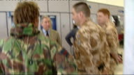 Prince Charles chats with British soldiers ENGLAND Oxfordshire RAF Brize Norton INT Prince Charles stands chatting with British soldiers in Brize...