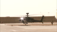 Prince Harry tour of duty in Afghanistan EXT AIR VIEWS / AERIALS over Afghanistan AIR shots of Apaches in flight Apache taxiing back at base GV...