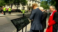 Prince Harry unveils plaque outside Westminster Abbey ENGLAND London Westminster Abbey EXT Car arriving / Prince Harry out of car and shaking hands...
