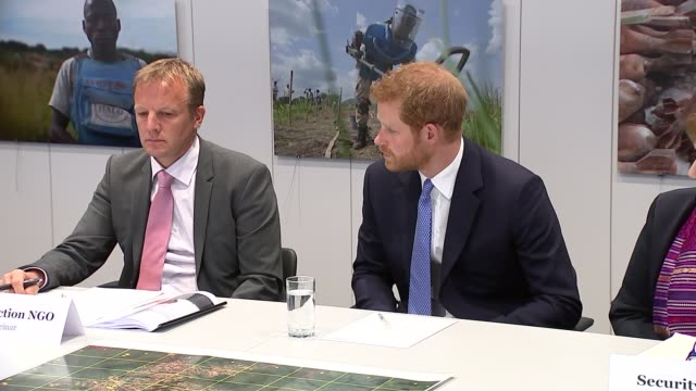 Prince Harry visits Chatham House to open the Stavros Niarchos Foundation Floor Prince Harry into conference room and sits / various of meeting...