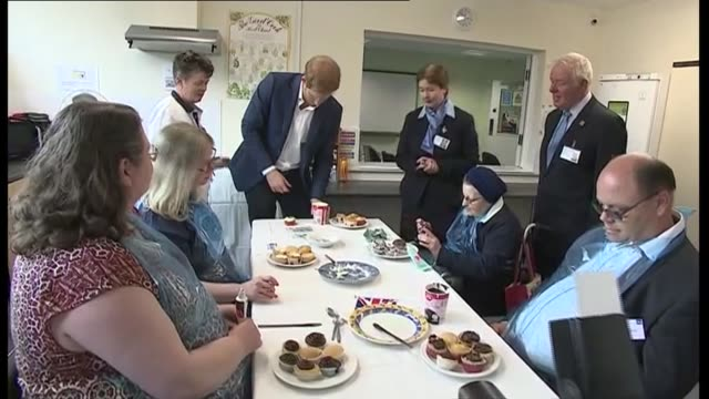 Prince Harry visits Headway charity in Ipswich Prince Harry blindfolded / Harry trying to ice a cupcake while blindfolded / Harry chatting to group...
