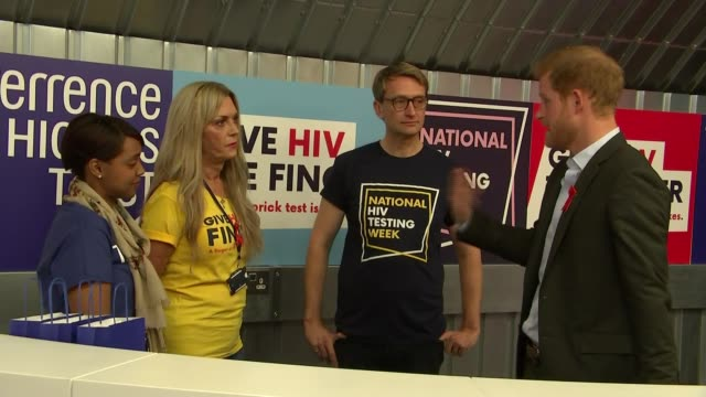 Prince Harry visits HIV popup clinic in East London Harry meets people from the Terrence Higgins Trust / Harry shown campaign badges etc / Harry...