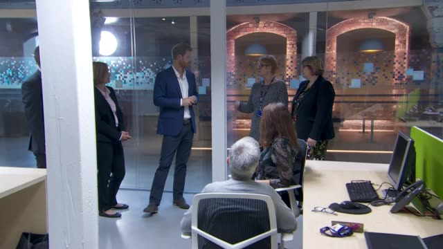Prince Harry visits NHS Manchester Resilience Hub ENGLAND Manchester EXT Prince Harry arrival and greeting people Prince Harry chatting with various...