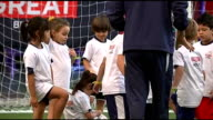 Prince Harry visits training base for Team GB in the Brazil 2016 Olympics Small children kicking footballs / small children with Brazilian and...
