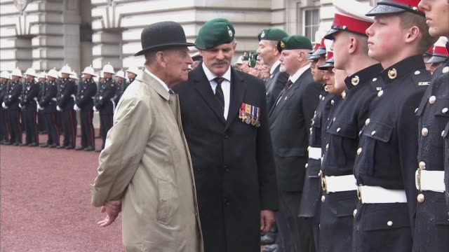 Prince Philip carries out last official public engagement EXT Prince Philip in bowler hat and raincoat chatting with Royal Marines on final Royal...