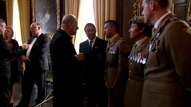 Prince Philip Duke of Edinburgh chatting with Gurkhas at an event marking 200 years of unbroken Gurkha service to the crown