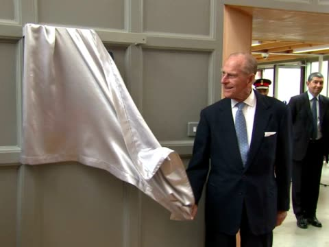Prince Philip Duke of Edinburgh unveils plaque with some trouble Prince Philip officially opened the Richmond Adult Community College and was shown...