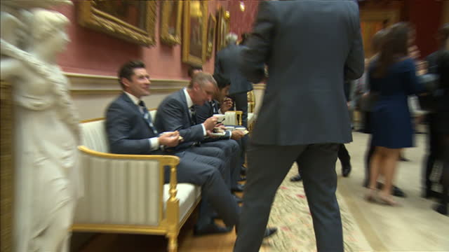 Prince Philip hosts event at Buckingham Palace for county cricket winners Shows interior shots Dickie Bird and Yorkshire players selecting food in...