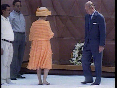 Indian comment row LIB INDIA Amritsar Queen and Prince Philip laying wreath at monument to sikhs shot dead by British troops LIB WALES Cardiff Queen...
