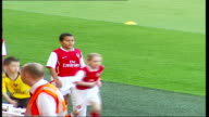 Prince Philip visiting Emirates Stadium for official opening and meeting Arsenal players General views of young football players wamring up at side...