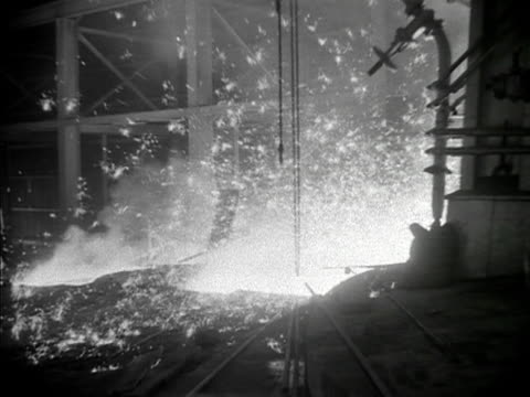 Prince Philip watches molten pig iron pouring out of the blast furnace at the Shotton steelworks in North Wales 1953