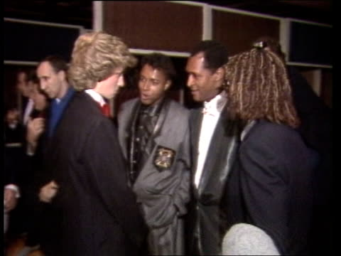 London TMS Princess Diana chatting to BV Peter Townsend IN to Diana MS Soul group Imagination PULL OUT to SIDE as Diana chatting to themCMS Diana...