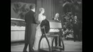 Prince Rainier and Grace Kelly draw a raffle winner's name at the 'Imperial Ball A Night In Monte Carlo' charity event at the WaldorfAstoria the...