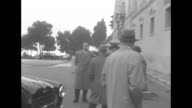 Prince Rainier's chaplain Father Francis Tucker exits his car and is escorted to The Prince's Palace