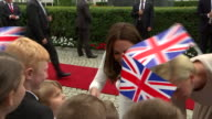 Prince William and Catherine Duchess of Cambridge greeting children in Warsaw Poland alongside the President and First Lady of Poland