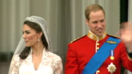 Prince William and Kate Middleton wedding day main events ENGLAND London EXT William Duke of Cambridge and Catherine Duchess of Cambridge kiss on...