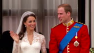 Prince William and Princess Catherine kiss and wave to the crowds from the balcony of Buckingham Palace Available in HD