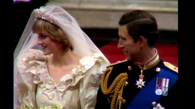 affect on UK economy TX St Paul's Cathedral INT Princess Diana and Prince Charles along down aisle on wedding day Procession of bridesmaids and page...