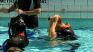 Prince William enjoys scuba diving at handover of presidency of SubAqua Club ENGLAND London Camden Oasis Sports Centre EXT Prince William sitting on...