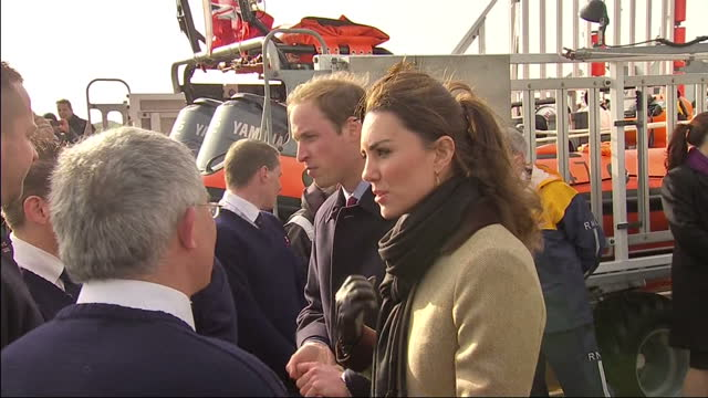 Prince William Kate Middleton chatting to RNLI lifeboat crew Prince William Kate Middleton in North Wales at Trearddur Bay on February 24 2011 in...