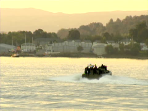 Prince William speedboat trip near Faslane Good shot of naval speedboat along in water reflecting sunset showing spray and bowwave More of boat along...