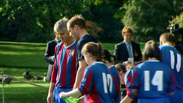 Prince William takes part in training session at Buckingham Palace Prince William Michael Owen and others listening to coach speak before applauding...