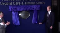Prince William the Duke of Cambridge unveils a plaque to mark the opening of Aintree University Hospital's Urgent Care and Trauma Centre and looks at...