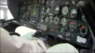 Prince William to learn to fly with the RAF RAF Cranwell Tucano T1 plane taxis on tarmac/ RAF instructor demonstrating controls in cockpit of...