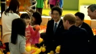 Day 2 Fukushima play school visit JAPAN Fukushima Prince William and Shinzo Abe playing in ball pit with children / William juggling / William and...