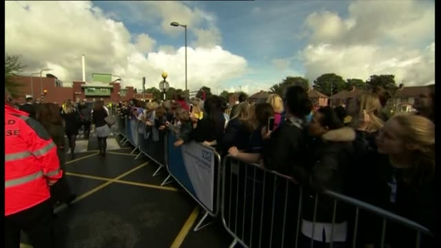 Prince William visits Aintree University Hospital ENGLAND Merseyside Liverpool Aintree University Hospital EXT People waiting behind barriers /...