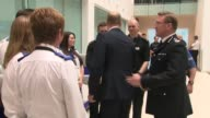 Prince William visits Greater Manchester Police HQ ENGLAND Manchester Greater Manchester Police HQ INT People waiting / picture of Queen / Prince...