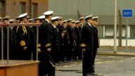 Prince William visits HM Naval Base Clyde Prince William saluting as National Anthem God Save the Queen played by military band SOT Various shots of...