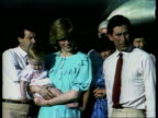 Princes Collection 3 INJ562 Alice Springs Diana holding baby Prince William alongside child at airport