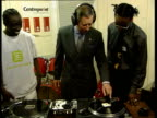 Prince's Trust 25th anniversary aNAT JOYCE London INT MS Prince Charles the Prince of Wales putting on headphones as trying hand at being DJ during...