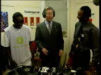 Prince's Trust 25th anniversary ROYAL London MS Prince Charles standing at record decks as takes off headphones NAT