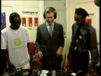 Prince's Trust 25th Anniversary ROYAL MS Prince Charles standing at record decks as takes off headphones