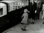 Princess Anne is 7 years old LIB Various locations EXT Princess Anne and Prince Charles walking to train at Euston station / On Romney railway —...