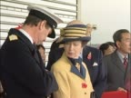 Princess Anne stands with husband Commander Tim Laurence at Heathrow as they wait for the arrival of Chinese leader Hu Jintao on a state visit