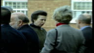 Staffordshire EXT Cars along / Princess Royal out of car greeted / Princess chatting then into prison building / Princess along meets prisoners in...