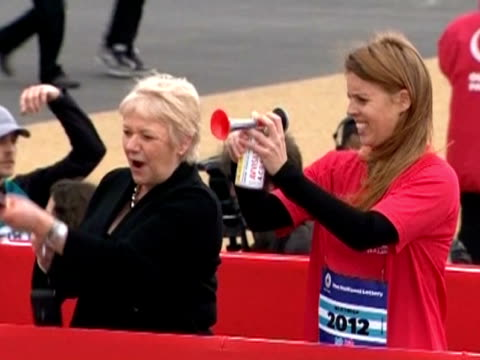 Princess Beatrice uses an air horn to mark the start of the Olympic park run
