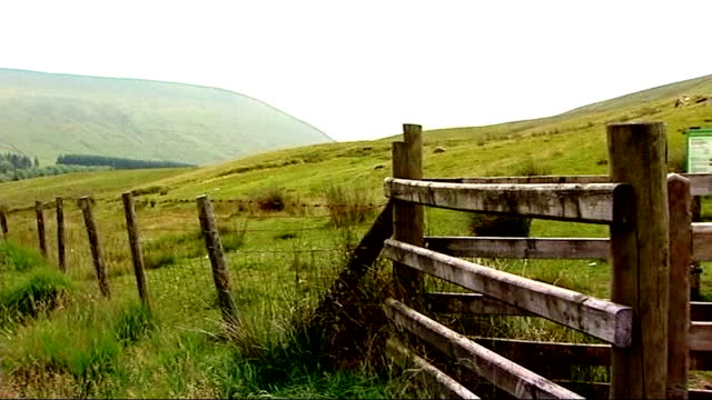 new claims surrounding her death LIB WALES Brecon Beacons EXT Fence and open countryside PAN Open countryside seen beyond grass in f/g